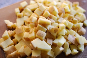 About an equal amount—a cutting board full—of CSA Yukon Golds.